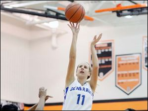 Anthony Wayne's Megan Bedard (11) takes a shot on the net.