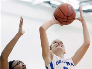 Anthony Wayne's McKenzie Krieg (22) takes a shot against   Lima Senior's Imara Haynes (30).
