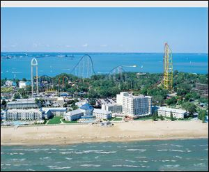 Cedar Point's parent firm will refresh its hotels and install computerized sales systems at four parks.