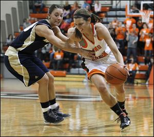 Chrissy Steffen, who led Bowling Green with 17 points, drives against Akron's Taylor Ruper in Wednesday night's game at the Stroh Center. The Falcons are 17-8 overall, 8-4 in the MAC.