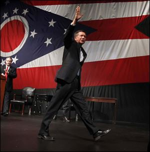 Ohio Gov. John Kasich waves goodbye after giving his State of the State address at the Veteran's Memorial Civic & Convention Center in Lima, Ohio.
