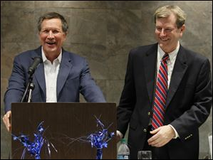 Ohio Governor John Kasich, left,  jokes with Lucas County Republican Party Chairman Jon Stainbrook.