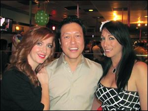 From left, Sara Yu and her husband Li Yu, owners of Spicy Tuna Sushi Bar, with Deitra Hickey, owner of Serenity Health and Wellness Center, hosted the 2013 charity event for autism.