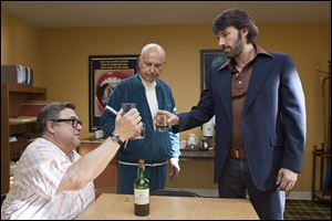 "John Goodman, left, Alan Arkin, center, and actor-director Ben Affleck in a scene from ""Argo."""