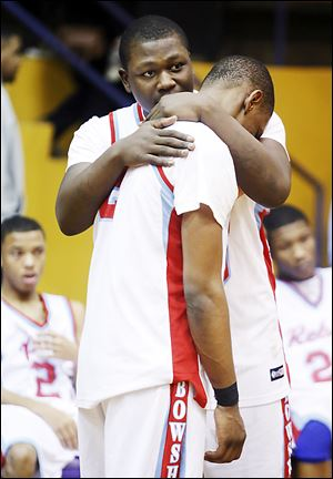 Bowsher's Mark Washington, right, consoles teammate Aundre Kizer after losing to Start in the City League championship game. Kizer scored a game-high 27 points.