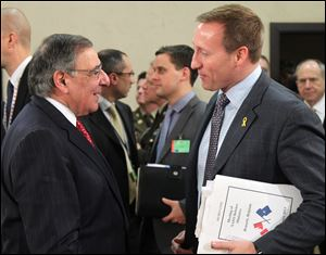 Canada's national defense minister Peter Gordon MacKay, right, talks with U.S. Secretary of Defense Leon Panetta, at the start of a two-day NATO defense ministers meeting to discuss Syria and Afghanistan, at NATO headquarters in Brussels, today.