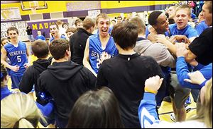 Anthony Wayne players and fans celebrate after beating Maumee to seal an outright Northern Lakes League championship.