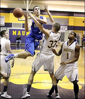 Anthony Wayne's Matt Fox is fouled by Maumee's Dillon Kline. Fox hit three 3s and scored 18 points to help the Generals win.
