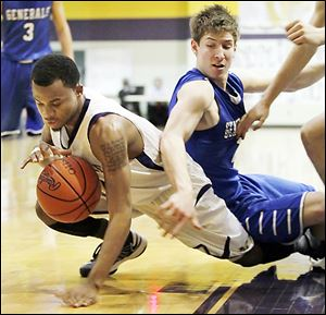 Maumee's Dominique King, left, who led the Panthers with 16 points, battles Anthony Wayne's Jake Reid.