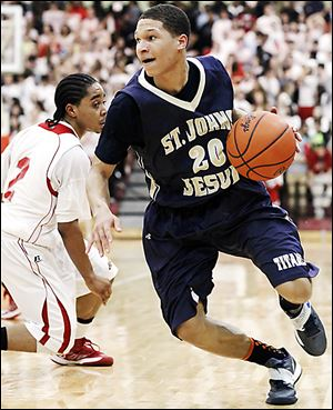 St. John's player Tyler Thompson drives past Central Catholic's D.J. Moody during their game Friday night.