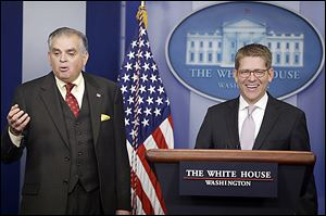 White House Press Secretary Jay Carney, at podium, and Transportation Secretary Ray LaHood discuss the likelihood of  a sequester and thus, budget cuts.