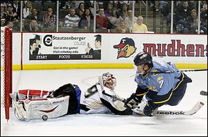 Toledo forward Nino Musitelli scores against Wheeling goaltender Peter Delmas  in the first period on Friday night. The Walleye scored four third-period goals to rally for a 5-2 victory.