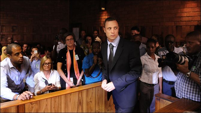 Olympic athlete, Oscar Pistorius , in court in Pretoria, South Africa, for his bail hearing charged with the shooting death of his girlfriend, Reeva Steenkamp.