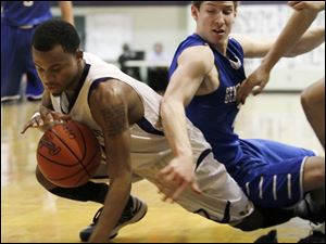 Maumee's Dominique King, left, and Anthony Wayne's Jake Reid battle for a loose ball.