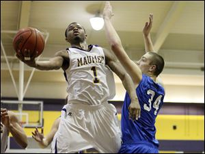 Maumee's Dominique King goes to the basket against Anthony Wayne's Mark Donnal.