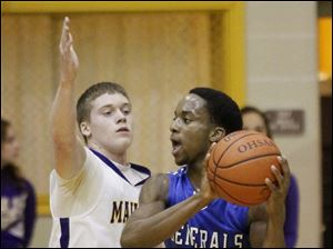 Anthony Wayne's Ose Omofoma is guarded by Maumee's Sean McGovern.