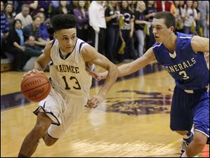 Maumee's Jason Wanamaker, 13, drives past Anthony Wayne's Matt Fox.