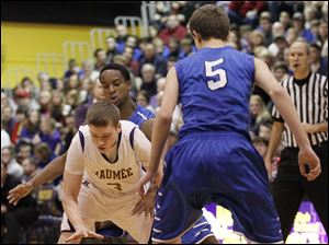 Maumee's Sean McGovern tries to dribble through Anthony Wayne's Ose Omofoma, back, and Hunter Debo, 5.