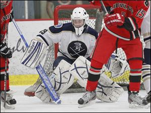 St. John's Jesuit goalie Mike Barrett, 29, keeps a close eye on the action during the first period.