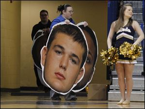 A likeness of UT's Nathan Boothe is carried into the arena.