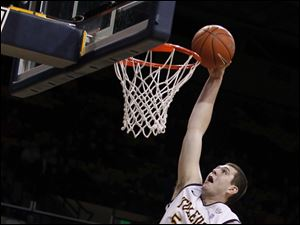 Toledo's Nathan Boothe goes up for a dunk.
