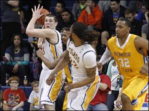 Toledo's Nathan Boothe steals the ball and looks down court for an open man.