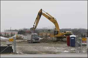 Land is cleared as work in underway to build a Kroger at the former site of an Ed Schmidt auto dealership at the corner of Dussel and Conant in Maumee.