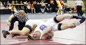 Bryan wrestler Brock Nagel finds himself on his back against Luke Cramer of Oak Harbor during their 170 pound district final. Cramer won the match with a 17-2 technical fall.