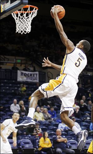 Toledo's Rian Pearson soars for two points during the game against McNeese State. Pearson had a game-high 21 points.