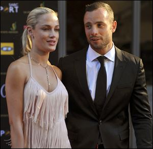 A November photo of Oscar Pistorius and his girlfriend Reeva Steenkamp, whom he has admitted he killed in a recent incident in his apartment.