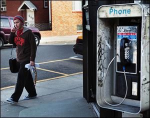 Dave McClelland, of Guttenberg, strolls along Bergenline Avenue at the North Bergen-Guttenberg border with a cellphone pressed to his ear.