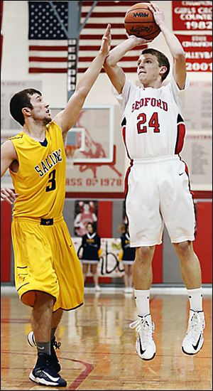 Bedford's Dylan Barr shoots against Saline's Reece Dils. Bedford improved to 15-3 on the season.