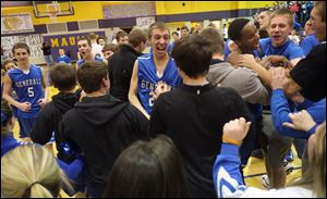 Anthony Wayne players and fans celebrate after beating Maumee and winning the NLL on Friday night at Maumee High School.