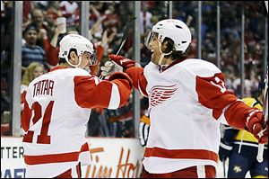 Detroit Red Wings center Tomas Tatar (21) is congratulated by right wing Patrick Eaves after scoring during the second period against the Predators.