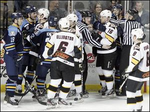 The referees contain a fight between the Walleye and Cyclones.