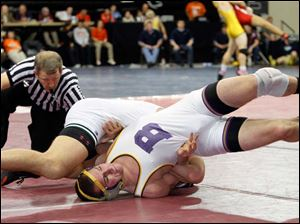 Bryan wrestler Brock Nagel finds himself on his back against Luke Cramer of Oak Harbor during their Division II 170 pound district final.