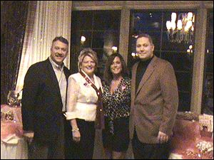 Co-chairmen for Hearts of Fire event Debbie Katich, center left, with husband, Steve, and Dana Mollenkamp, center right, with husband Patrick.