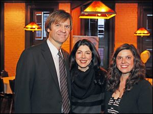Graham's Foundation founders Nick Hall and his wife Jennifer, pose with Erin McPartland during Graham's Foundation Power to the Grow fund-raiser at Mancy's Steakhouse.