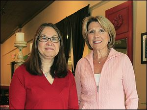Mei Mei Williams, left, and Joan Nichols host Party of Note for the Toledo Symphony League at Sylvania Country Club.