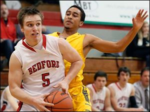 Bedford's Bradley Boss (5) drives past Saline's Gabriel Becton (11) Saturday in Bedford.