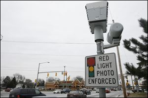 A camera on the southbound corner of Secor Road and Monroe Street is one of 43 scattered around the city. The devices have withstood numerous legal challenges.