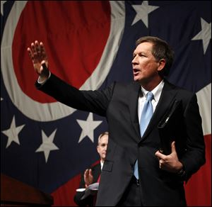 Gov. John Kasich waves after delivering his State of the State address at the Veterans Memorial Civic and Convention Center in Lima.