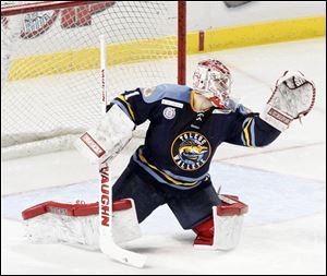 Walleye goalie Jordan Pearce stops the puck against Cincinnati. He finished with 25 saves on Sunday.