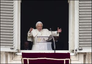Pope Benedict XVI gives his blessing in his last Angelus noon prayer. At Sunday's service, cheers from the packed St. Peter's Square greeted the retiring Pontiff, 85.