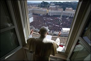 Pope Benedict XVI delivers his blessing during his last Angelus noon prayer, from the window of his studio overlooking St. Peter's Square, at the Vatican, today.