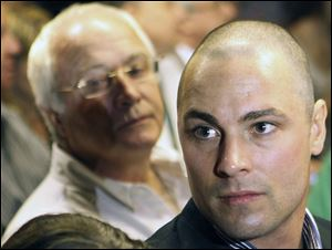 Carl Pistorius, right, the brother and father of Olympic athlete Oscar Pistorius, attend Oscar's bail hearing at the magistrate court in Pretoria, South Africa, last week.