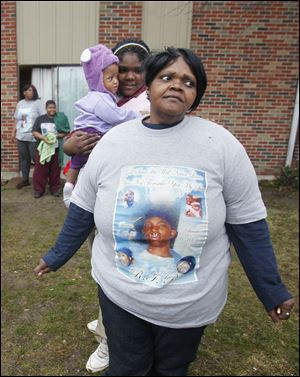 Gwendolyn Robinson, front,  dons a shirt memorializing her son.