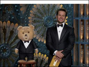 Ted and Mark Wahlberg present at the Oscars.