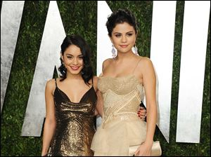 Vanessa Hudgens, left, and Selena Gomez arrive at the 2013 Vanity Fair Oscar Party.
