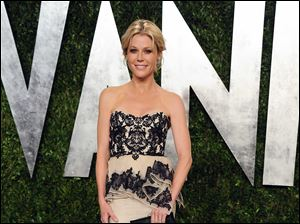 Actress Julie Bowen arrives at the 2013 Vanity Fair Oscar party at the Sunset Plaza Hotel in West Hollywood, Calif.